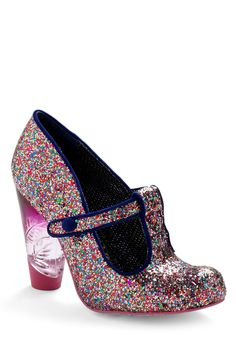 The instant you take your place in the spotlight, these T-strap heels, found exclusively at ModCloth, shine with an awe-inducing exterior clad completely in multicolor glitter. Finished with a fading fuchsia heel that's etched with a signature floral motif and indigo trim on every edge.
