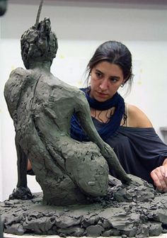 Silvia Juez, artist working on her reclining female figure sculpture at The Florence Academy of Art, 2014.