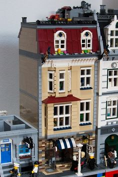 Butcher Shop with Apartments above by Andreas Grögel on MOCpages. I like this. I like the bay window & roof above it on the 2nd floor, I also like the rounded bay window on the 3rd floor. The street level is cool with all the different plates. I might have made them 2 rows in each color just to give them a little more substance and kept it from seeming so busy. But overall a great buillding.