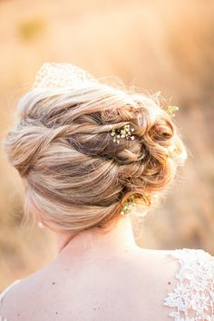 Rustic Bridal Upstyle with sprigs of Baby's Breath and a birdcage veil.