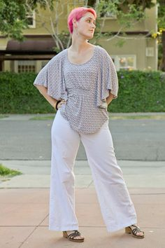 Wide leg white linen pants, purple Target batwing top, pink hair.