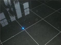 We love the effect that these black glitter quartz tiles create, it's like having a solar system in your kitchen!
