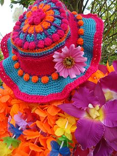 A colouful and fun party hat. Crocheted in four colours. There is only one size for a head circumference measuring 55 and a half centimeters. Keeping in mind that crochet is very stretchy, it will fit large sizes. For a smaller size, I suggest to use a thinner yarn or sew in a sweatband.