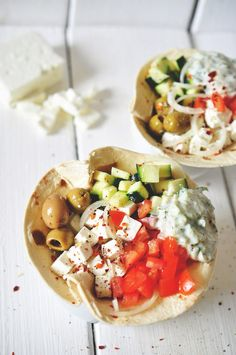 Greek Salad Wraps With Tzatziki _ Salad of: tomato, cucumber, onion, feta cheese, garlic spiced olives. Add some of the salad and tzatziki onto an amaranth or whole wheat tortilla and eat like a wrap.