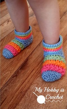 """The """"Starlight Toddler Slippers"""" are made using a variation of the star stitch. They look adorable in rainbow colors, but you could choose to crochet them using one solid color or as many colors as you wish."""