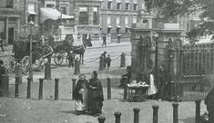 A fruit and vegetable seller outside St Stephen's Green, Dublin, c.1887, (pre Fusiliers' arch, which was erected between 1906 and 1907). Image courtesy of Don Doyle. #streettraders Saint Stephen, Fruits And Vegetables, Dublin, Ireland, The Outsiders, Saints, Arch, Green, Image