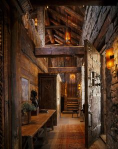 Log cabin entrance. Reclaimed Wood Beams & Large Scale Proportions emphasize Strong Rustic Warmth. Photo by Matthew Millman