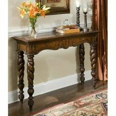 04576-850-001 Arianna Console by Ambella. $980.00. The exotic flair of the Arianna Console Table comes in part from the marquetry top and the fabulously turned rope style legs Design detail is evident in every aspect of this accent table