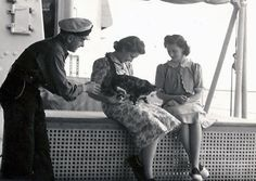 The Queen (when Princess Elizabeth) and a cat. I love this pic. So cute. You got to love Queen Elizabeth.