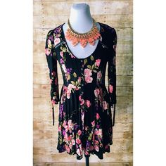 Urban Outfitters Ecoté Boho Black Floral Dress Like new, super stylish boho dress from Ecoté. Beautiful, bright floral print, button front, and ties in back and on sleeves. Perfect, lightweight summer dress! Like new condition! Urban Outfitters Dresses