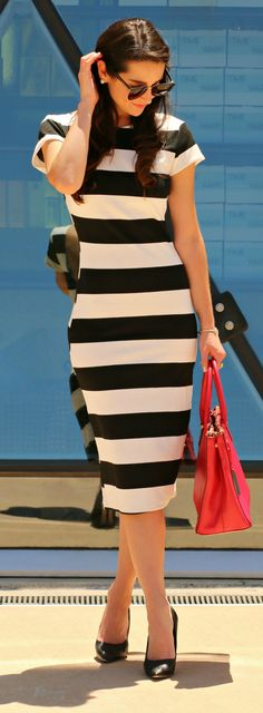 Classic black and white striped midi dress with black pumps and a red Ralph Lauren satchel with ASSETS by Spanx Reversible Flipside Firmers  | Where to Find Affordable Shapewear That Actually Works