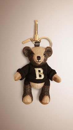 A Burberry charm featuring Thomas Bear, our signature teddy, in soft check cashmere. Discover more accessories at Burberry.com