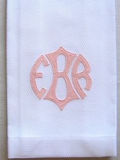 A classic design, this Applique Monogram Guest towel will bring an elegant touch to your bath.  Towels are 75 each, but due to the amount of work required in making applique, a minimum of 6 required to place order.Monogram is made from 100% cotton sateen and comes in 8 colors: red, golden buff beige, bright white, yellow, pink as shown, lavender, sky blue, and soft green.Select from our three standard guest towel fabrics: sand linen, ivory linen or white cotton pique as shown.