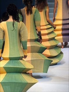 Issey Miyake - although these show up in a fashion show, obviously no one expects these gowns (?) to be worn. So I'm putting them here as sculpture.