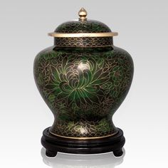 The Emerald Green Cloisonne Cremation Urn (large) features a magnificent design with vivid colors. The cloisonné urns will create a memorial for your loved one for generations to come. The cloisonné urns were made in ancient China, and are still made the same way they have been for centuries. The time-honored process originated in Beijing in the 12th century. Tiny copper filigree partitions are created, and through a process of soldering and heating, put on a metal urn.