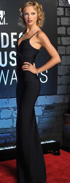 Channelling old glamour...Tyalor Swift looked very vintage Hollywood in her plunging navy blue gown and curled blonde hair