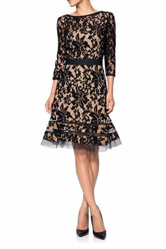 """Black and Nude ¾ Sleeve Lace Overlay Cocktail Dress. Bateau Neckline and Peek-a-Boo Cutouts at Hem. Stretch Belted Waist, Flared Skirting, and Hidden Back Zip. Approx. 40"""" L A perfect choice for an evening out, a day at work, or a special occasion.   Black Lace Dress by Tadashi Shoji. Clothing - Dresses Clothing - Dresses - Lace New Jersey"""
