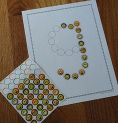 Using stickers with Lots of Dots   worksheets....letter recognition and fine motor activity