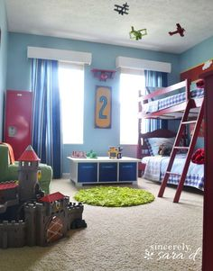 Adorable boys bedroom!  I love the airplanes hanging from the ceiling - buy airplane kits (just a few dollars each) and spray paint them.