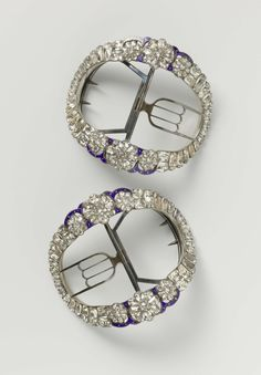 A pair of oval shoe buckles decorated with cut crystal and trimmed with blue enamel, ca 1785-1800.
