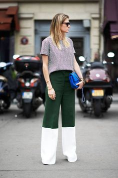 Photo: Amar Daved   Très chic in color-blocked pants and a patterned blouse.   Read more: June 12 Paris Street Style - Couture Fashion Week Street Style Pictures