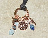 Leather Charm Necklace 'A Day at the Beach'. $46.00, via Etsy.