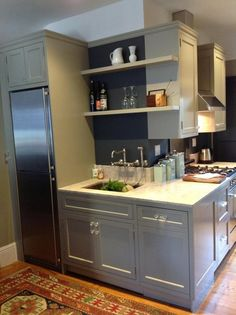 The cabinet color is Benjamin Moore Sandy Hook Gray and the walls are Valspar Blindfold. The cabinets were made by JRC Builders Inc in Oakland CA. I designed the cabinets and they built, painted and installed them.