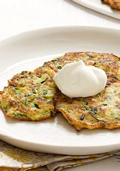 Zucchini Pancakes — Toss grated zucchini with eggs, Parmesan and buttery crackers. Cook in skillet. Top with sour cream. Serve up fresh zucchini pancakes and take a bow.