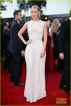 Iggy Azalea is a vision in white on the red carpet at the 2014 Grammy Awards held at the Staples Center on Sunday (January 26) in Los Angeles.