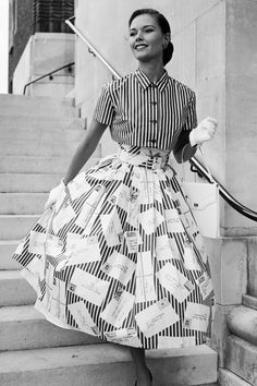 1957 A woman in a striped button-down and full circle skirt.