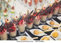 Beautifully decorated catering banquet table with different food snacks and appetizers with sandwich, caviar, fresh fruits on corporate christmas birthday party event or wedding celebration - stock photo Wedding Finger Foods, Party Finger Foods, Wedding Reception Food, Wedding Catering, Catering Logo, Catering Services, Wedding Ideas, Summer Recipes, Healthy Dinner Recipes