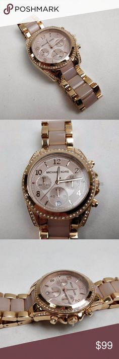 Michael Kors MK4953 Women's Blair Two-tone Watch Never been worn, excellent condition. Comes without box and accessories.  Date display at the 6 o'clock position. Chronograph - three sub-dials displaying: 60 second, 60 minute and 24 hour. Quartz movement. Scratch resistant mineral crystal. Pull / push crown. Solid case back. Case diameter: 38 mm. Case thickness: 11 mm. Round case shape. Band width: 20 mm. Fold over clasp with safety release. Water resistant at 100 meters / 330 feet…