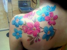 Pink and blue floral tattoo done by Luis at Lovecraft in Hamden, CT. by melisa