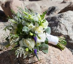 """Lorie with Vows, Estes Park designed a truly unique bouquet for Stephanie - Stephanie is a professional chef and really didn't have a preference on her bouquet, so Lorie created one with fresh herbs - rosemary, thyme, basil, lavender and a truly """"SCENTSATIONAL"""" bouquet was born!"""