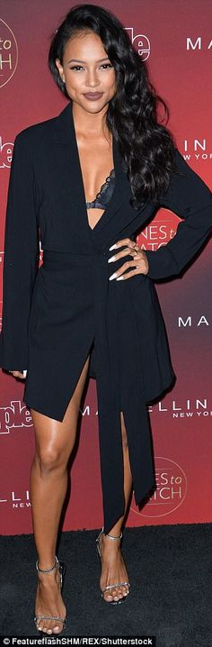 So chic: The 29-year-old model and gal pal of Christina Milian had flung her wavy hair ove...