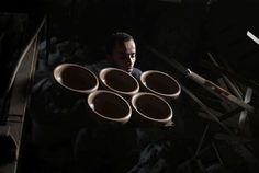 Tuesday, November 22: Gaza City  -   A Palestinian worker carries newly made pottery to be dried at a pottery workshop in Gaza City on Sunday, Nov. 20, 2016