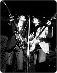 """#JohnLennon and #PaulMcCartney on stage during a January 1965 rehearsal. Although Lennon is briefly using his new 1961 #fender #stratocaster during rehearsal, he would switch to #Rickenbacker 325 Rose-Morris Model """"1996"""" for the actual performances.  #BlackandWhite #hofner #electricguitar #bass #bassguitar #thebeatles #beatlesgear #beatlemania #classicrock #beatles #beatleslive"""