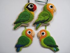 Set of 4 lovebird ornaments.  Eeep!!! We have two peach-faced lovebirds, just like the ones at the bottom! I love them!!