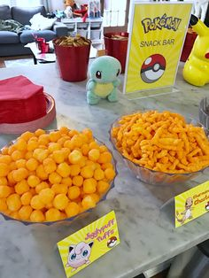 Pokémon snack bar for a Pokémon-themed birthday party. Click or visit FabEveryday.com to see details and DIY instructions for a Pokémon or Pokémon Go themed kid's party, including printables, food, decorations, favors, and party activities.