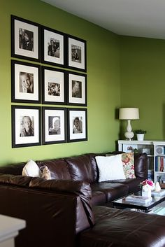 I really love this family room set up - from the green walls to the photo gallery above the sofa to the sofa itself! Hmm... leather sectional!