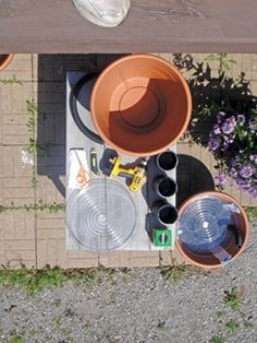 Self watering planters; VERY good article/instructions! You must register on the Cabin Life site, but it is worth it! Diy Self Watering Planter, Self Watering Containers, Home Vegetable Garden, Herbs Garden, Garden Planters, Drain Tile, Garden Projects, Garden Ideas, Garden Tips