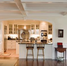 I am thinking something similar to this. Opening up wall between kitchen and dining room.