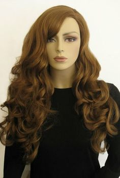 £28.49 - Light Brown wig, long, wavy: Isha  An long brown wig that has playful, twisty curls with glam side-parting.
