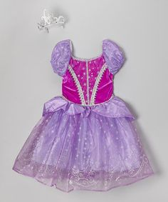 Make any dress-up day even more magical with this enchanting princess gown. Glitter stars and puff sleeves give it a bit of regal glitz, while the silver tiara demands bows and curtsies from all who pass by.