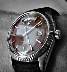Ox-blood (Brown-Red) dialled white gold vintage Rolex Day-Date Presidential (ref: 1807). Curved Glass.