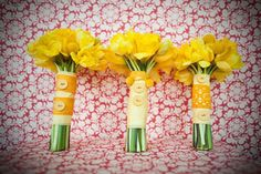 Bridesmaid bouquets- yellow daffodils, ribbons, and buttons