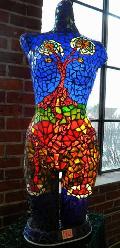 mosaic art on a mannequin torso  Mannequin Madness sells used and distressed mannequins and mannequin parts to artists to have a canvas to create projects like this.