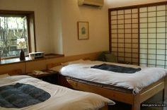 Dazzling Beige Wall Japanese-Inspired Shared Bedroom Decorating with Twin Minimalist Wood Frame Beds
