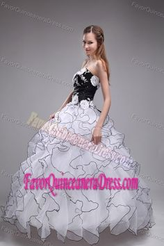 Embroidered White and Black Organza Quinceanera Dress with Ruffles and Flowers
