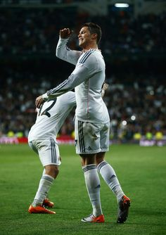 Cristiano Ronaldo of Real Madrid celebrates his team's third goal during the La Liga match between Real Madrid CF and FC Barcelona at the Bernabeu on March 23, 2014 in Madrid, Spain.